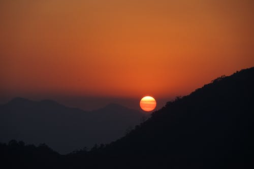 Silhouette of Mountains on an Evening Sun
