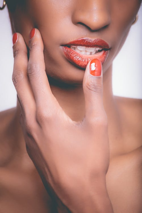 Woman With Red Lipstick and Red Manicure