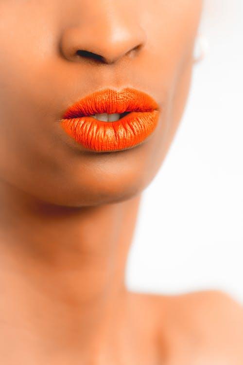 afroamerikansk kvinde, appelsin, close-up