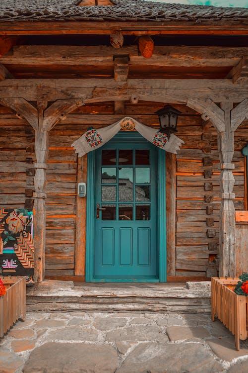 Blue Wooden Door with Brown Wooden Frame