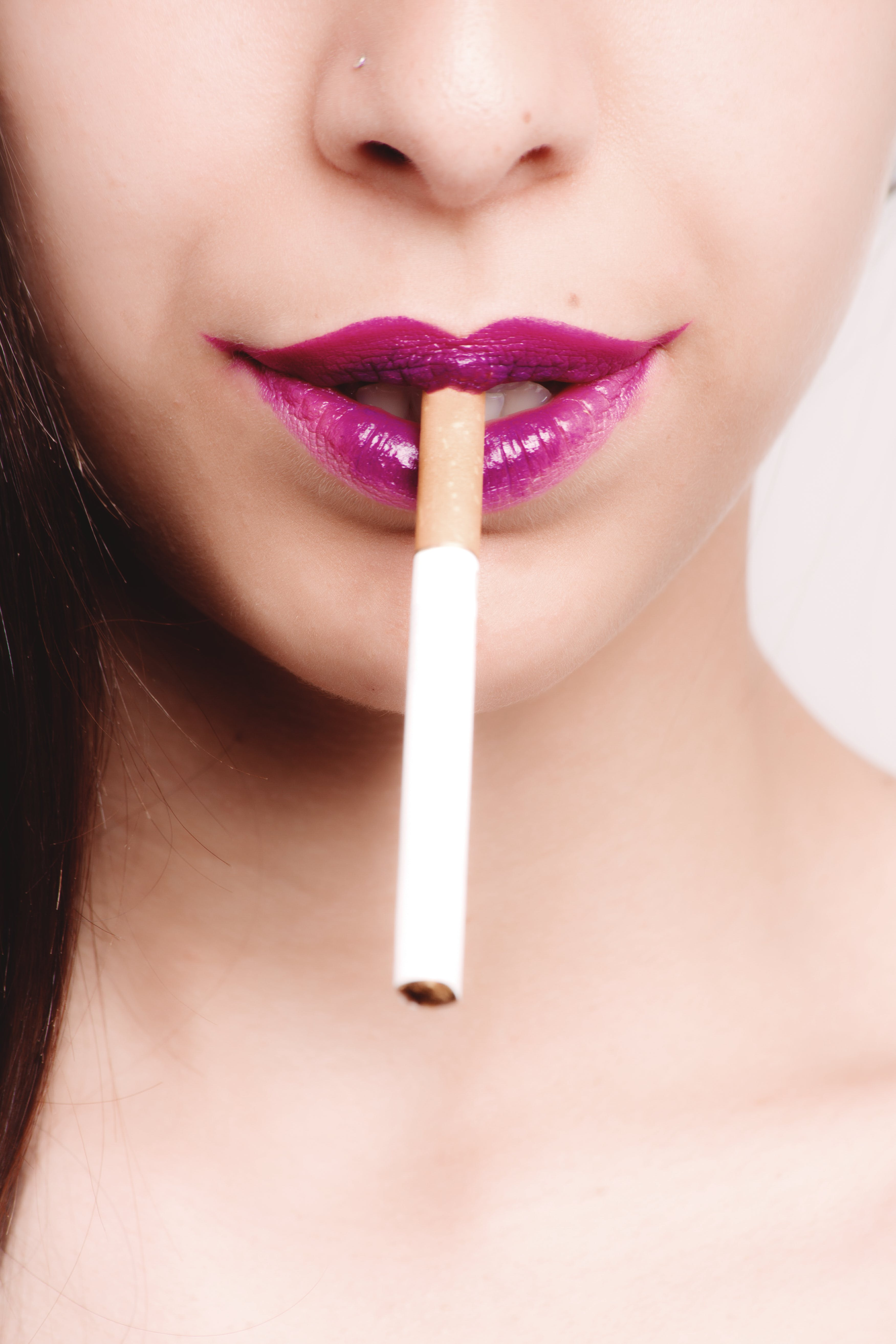 White Cigarette Stick on Woman's Mouth