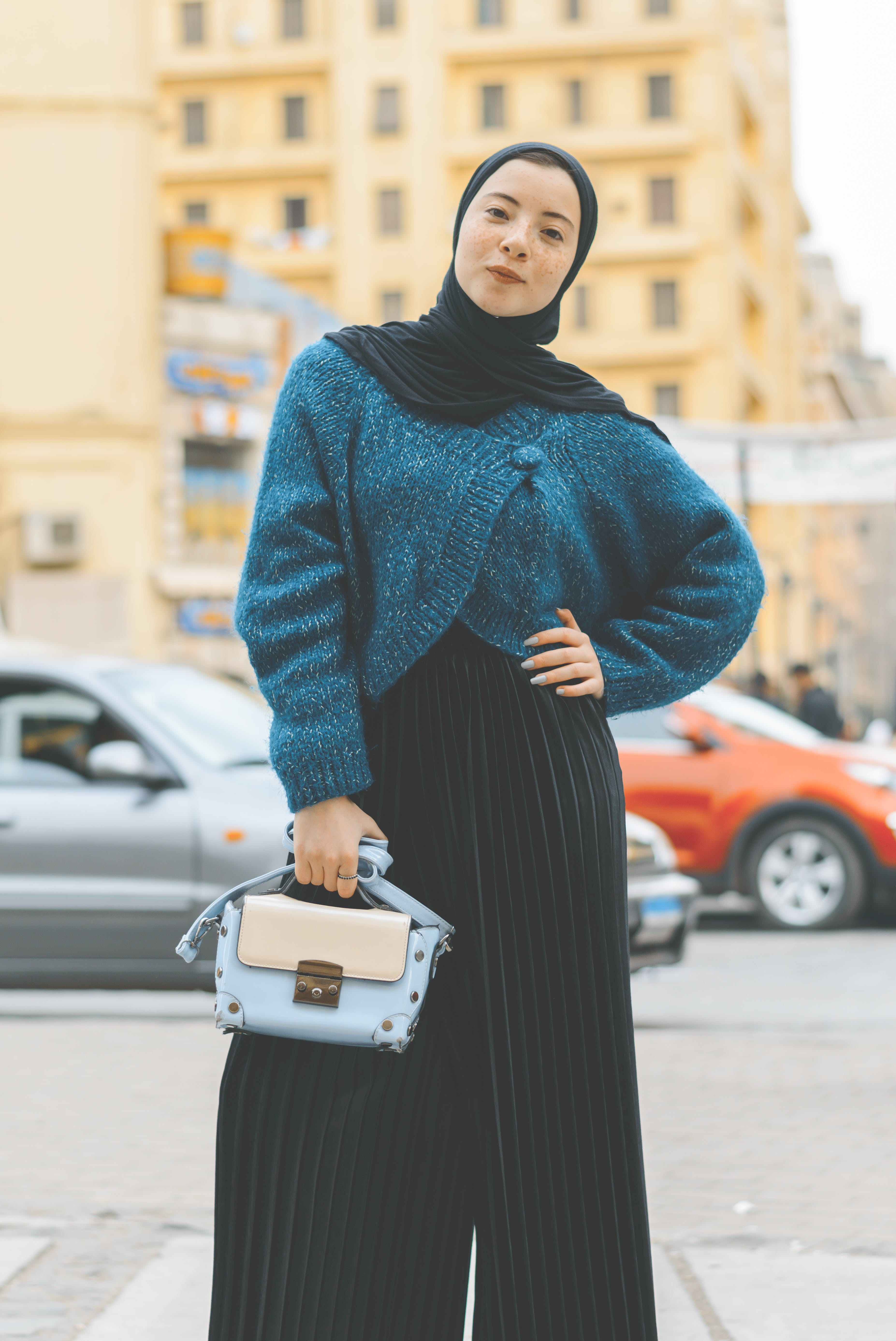Woman Wears Blue and Black Sweater With Pants