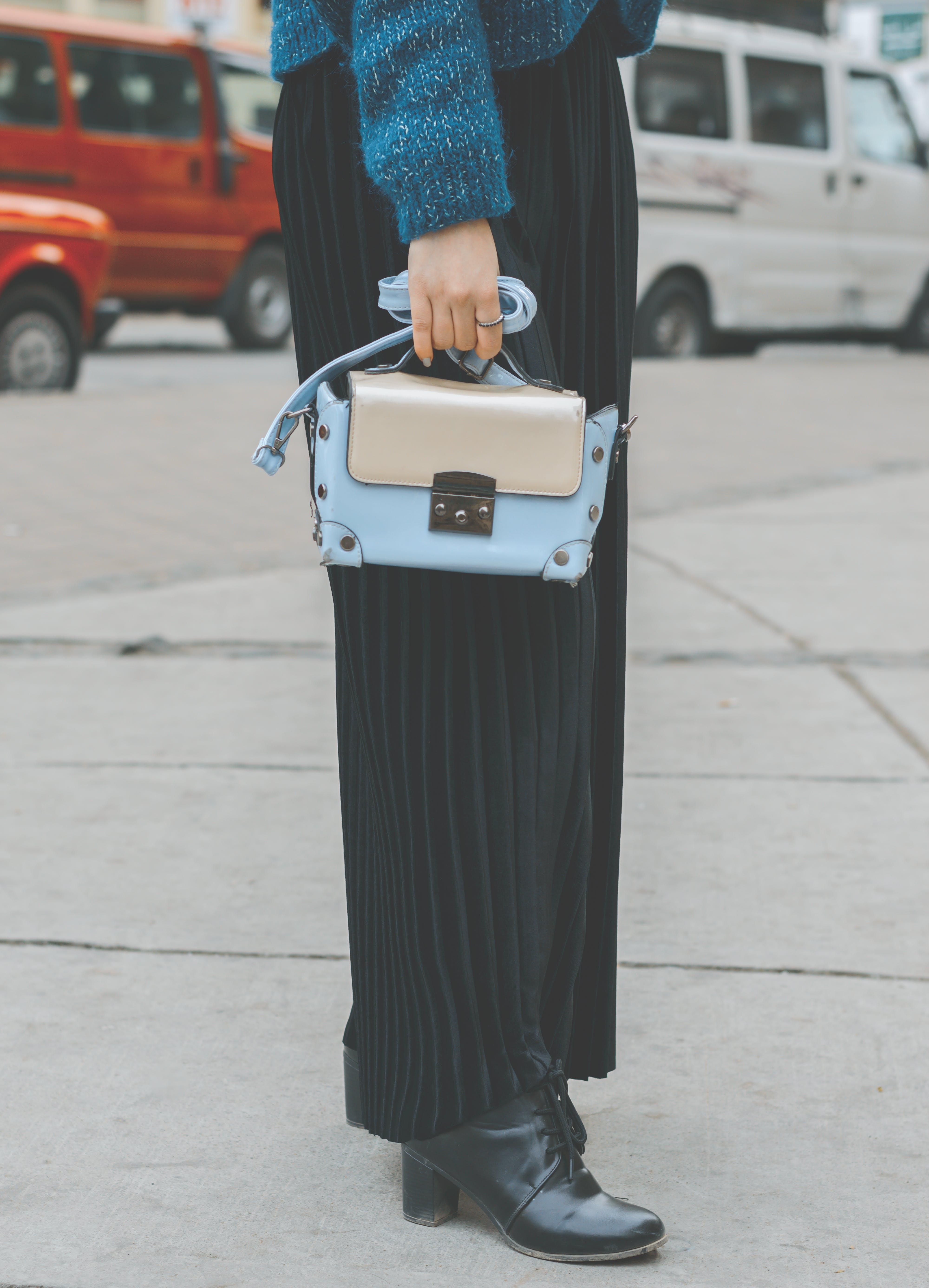 Woman Wearing Blue Leather Purse