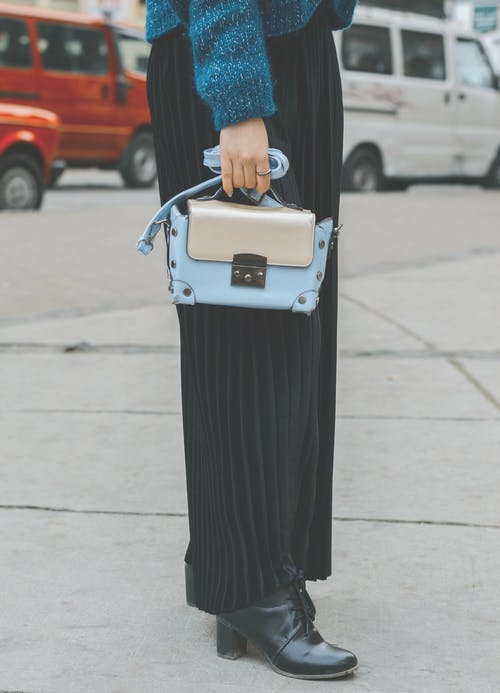 Woman Wearing Blue Leather Purse