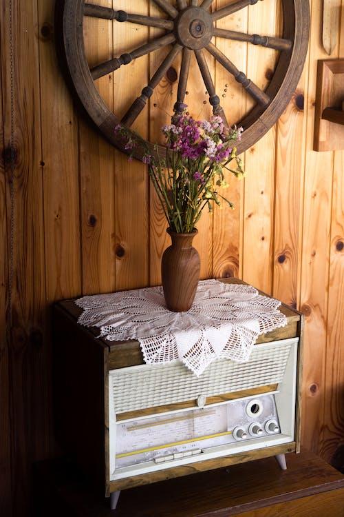 Purple Flowers on a Wooden Vase