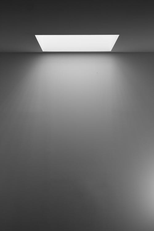 Grayscale Photography of White Concrete Wall