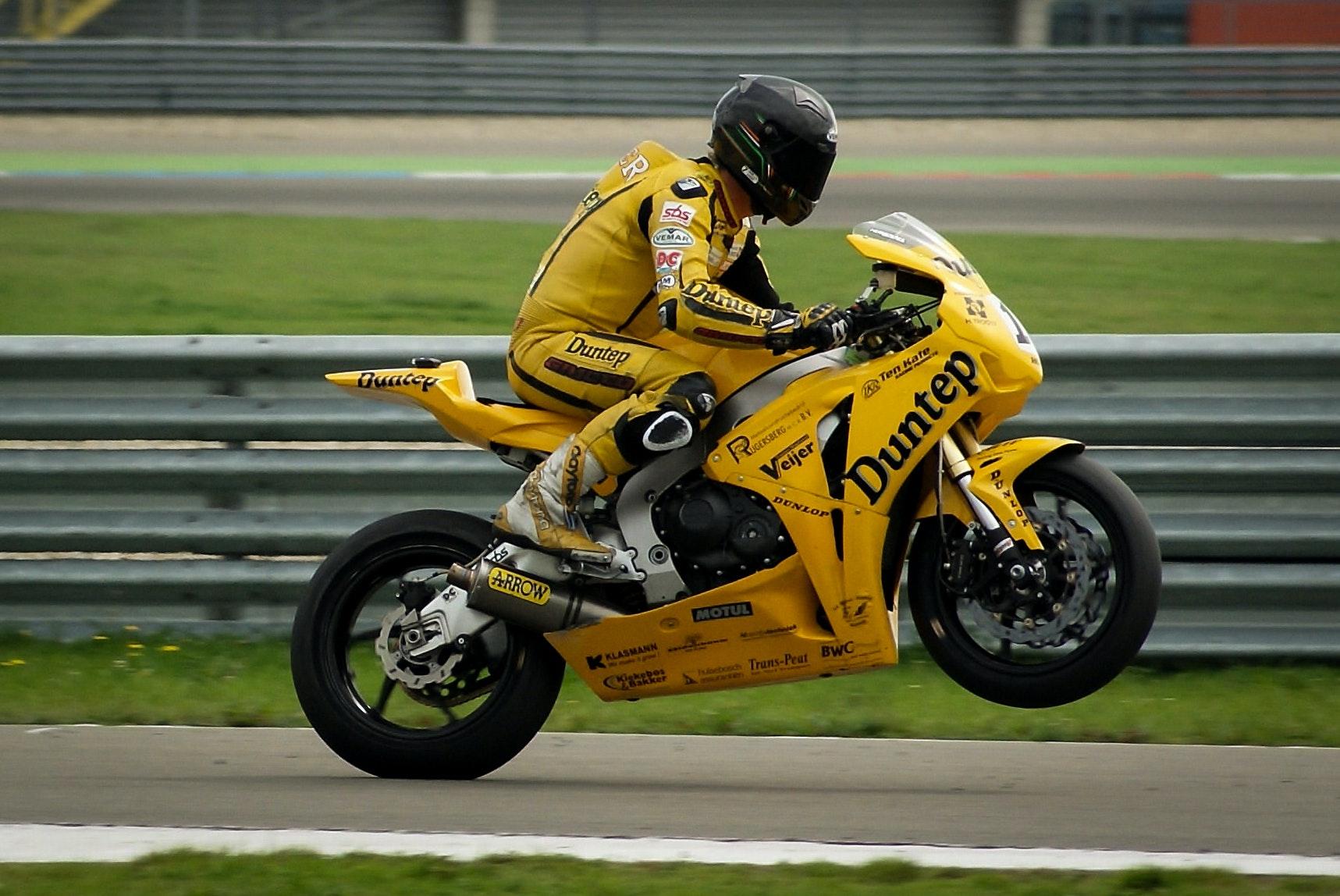 Person Riding On Yellow Sports Bike Free Stock Photo