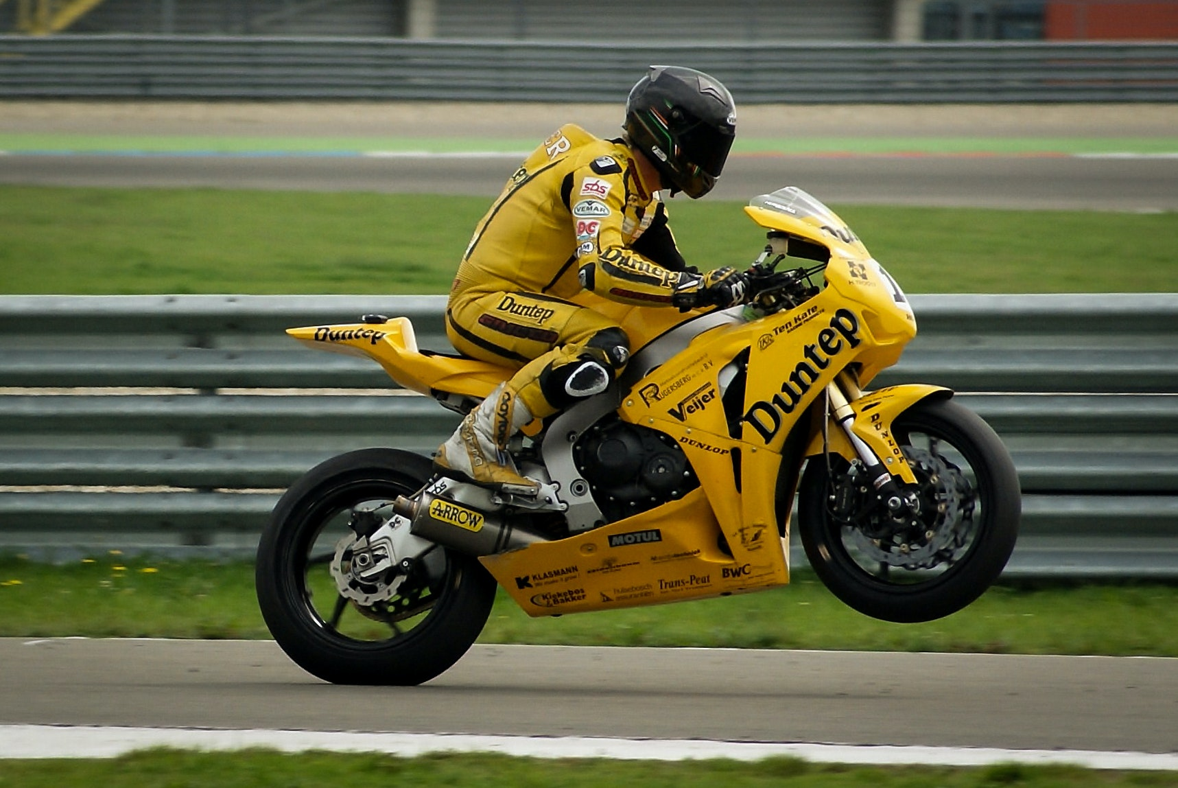 Person Riding On Yellow Sports Bike Free Stock Photo