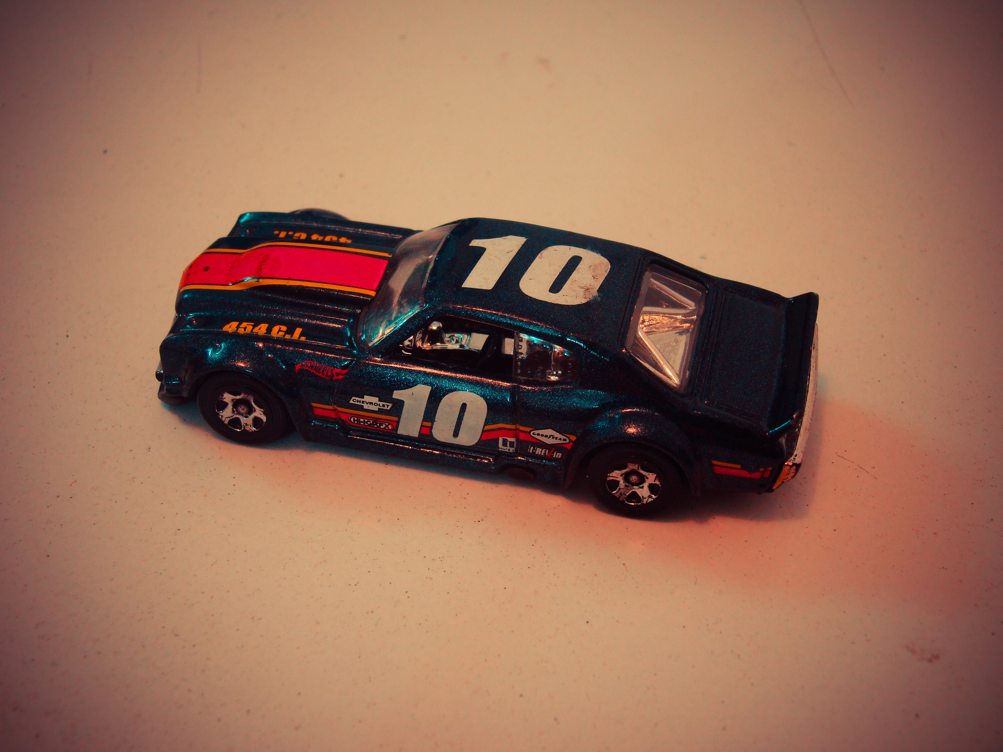 Teal Red and White Die Cast Model of Racing Car