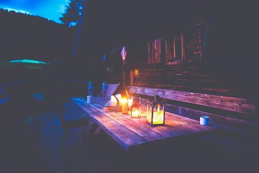 Black Lantern on Brown Wooden Table Under Blue Sky