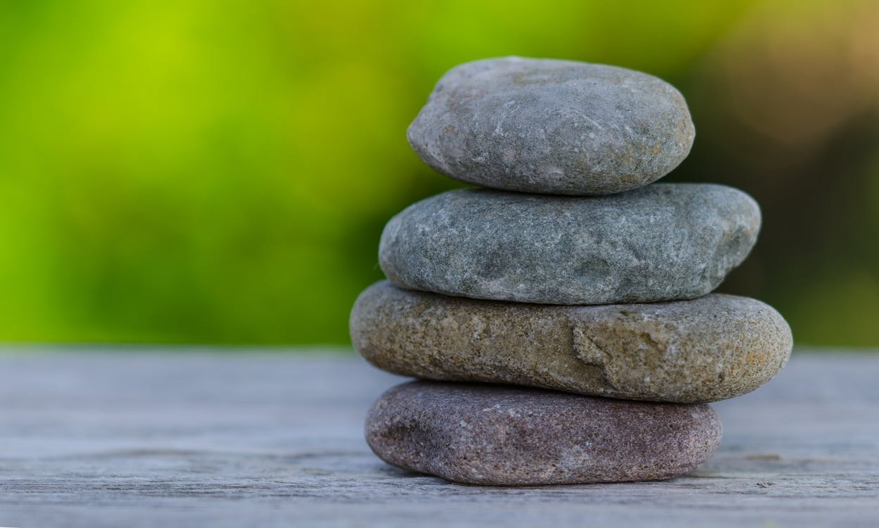Selective Focus Photography of Stack Stones