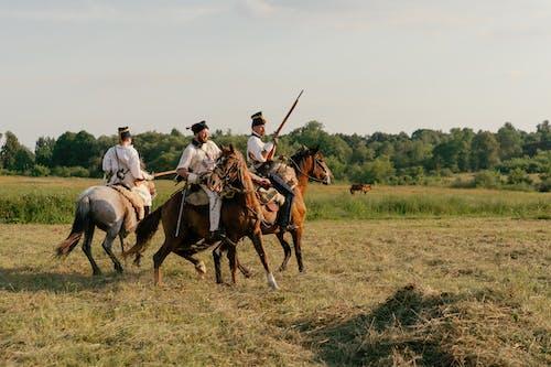 Men on Horses with Guns Recreating Historical Battle