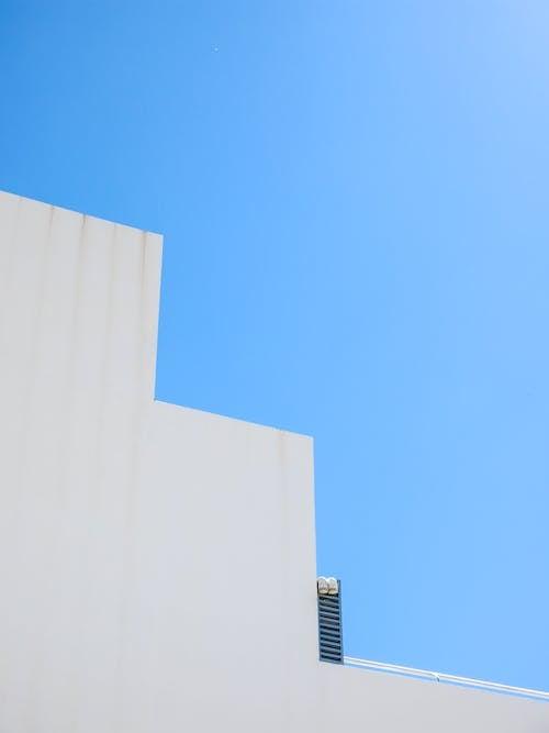 Foto d'estoc gratuïta de alt, arquitectura, buit, cel blau