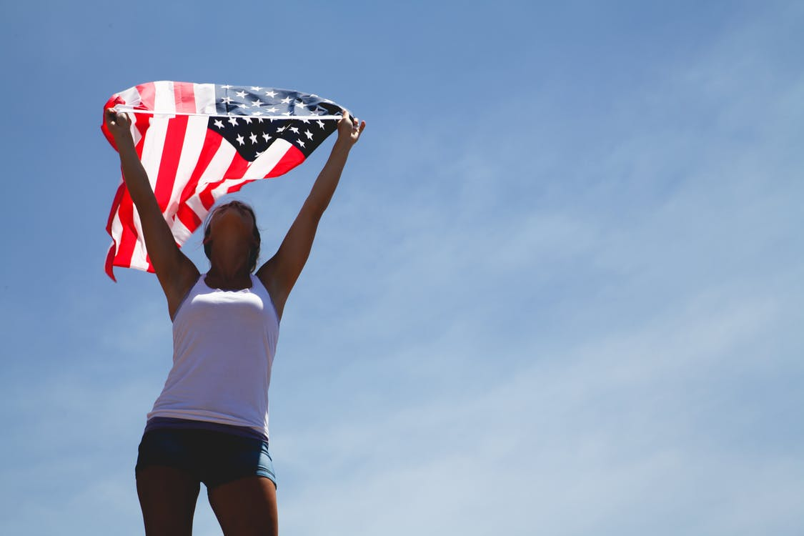 Woman Holding Us Flag during Daytime