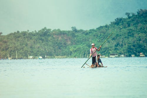 Photo of Men Fishing