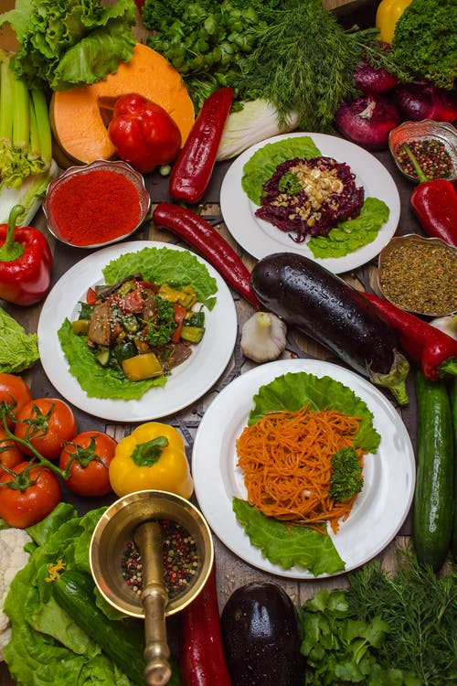 Plates with Food Beside Vegetables