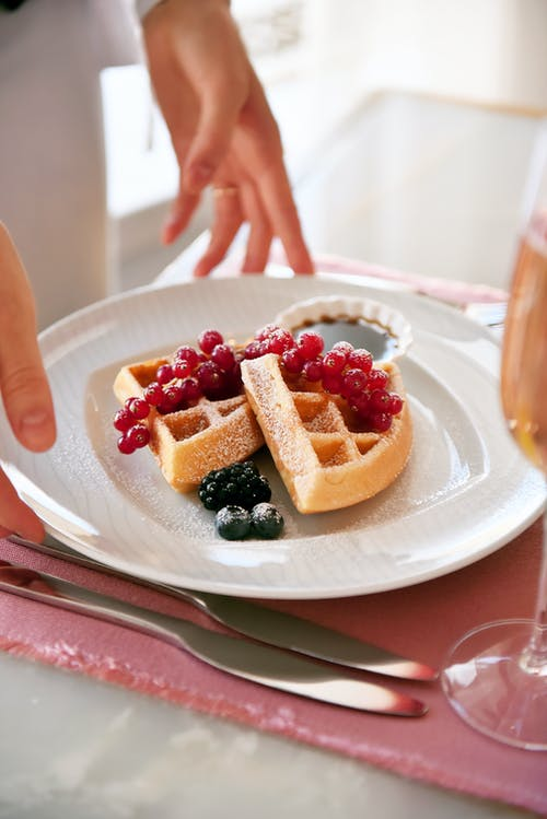 Waffle With Strawberry and Blueberry on White Ceramic Plate