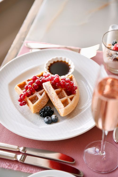 Waffle With Strawberry on White Ceramic Plate