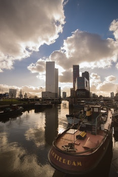 Free stock photo of city, clouds, skyline, boat