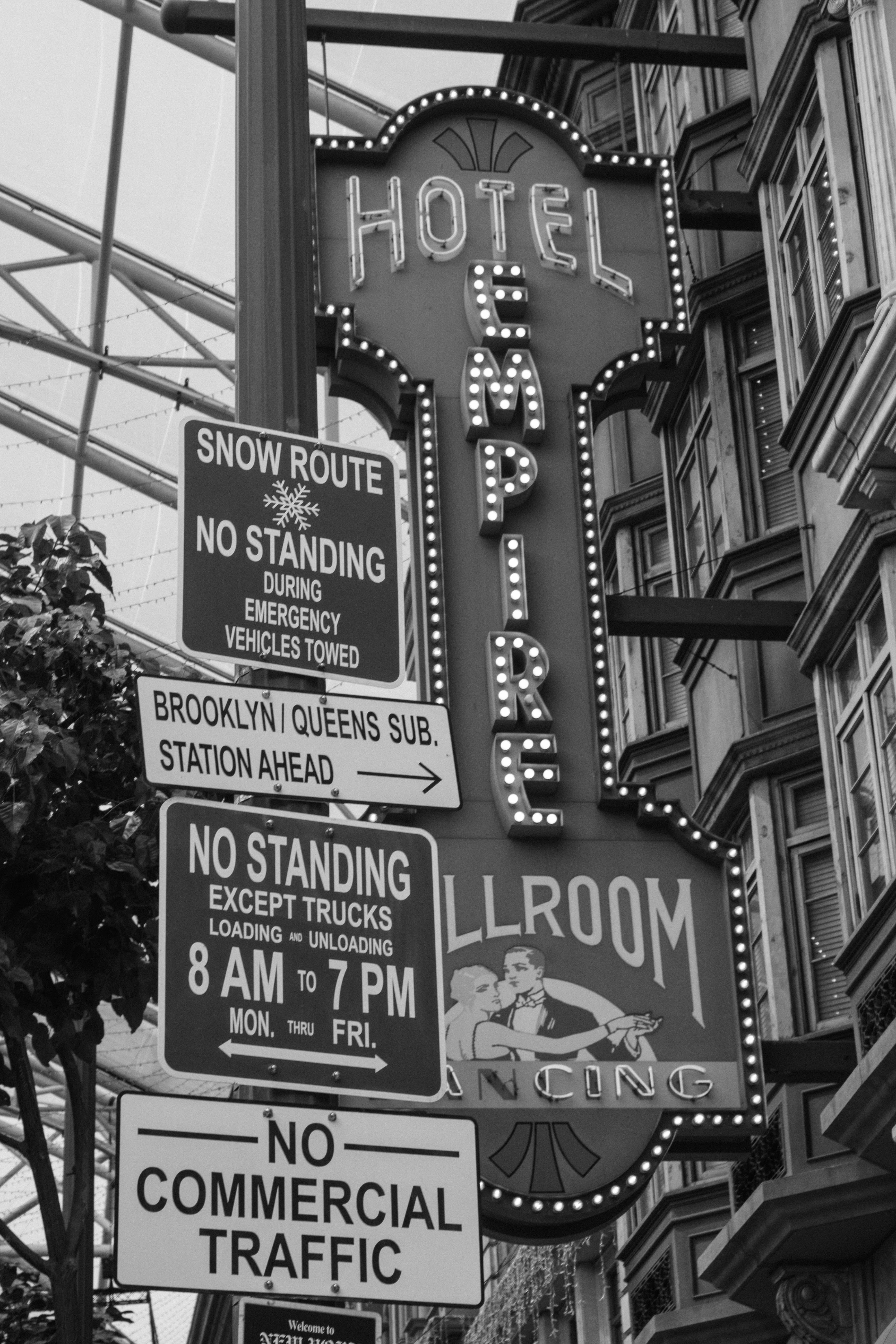Grayscale Photo of Hotel Empire Signage