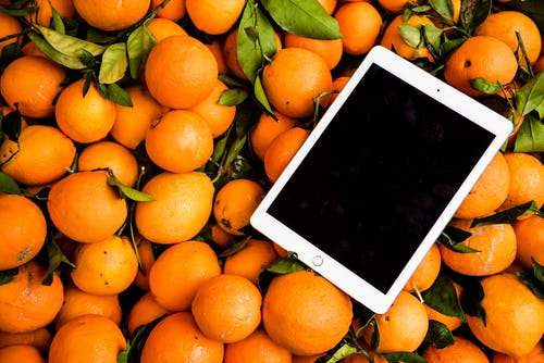 Photo of Ipad on Orange Fruits