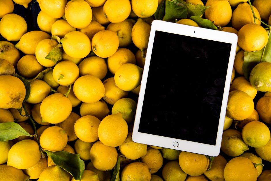 Photo of Ipad on Pile of Lemons