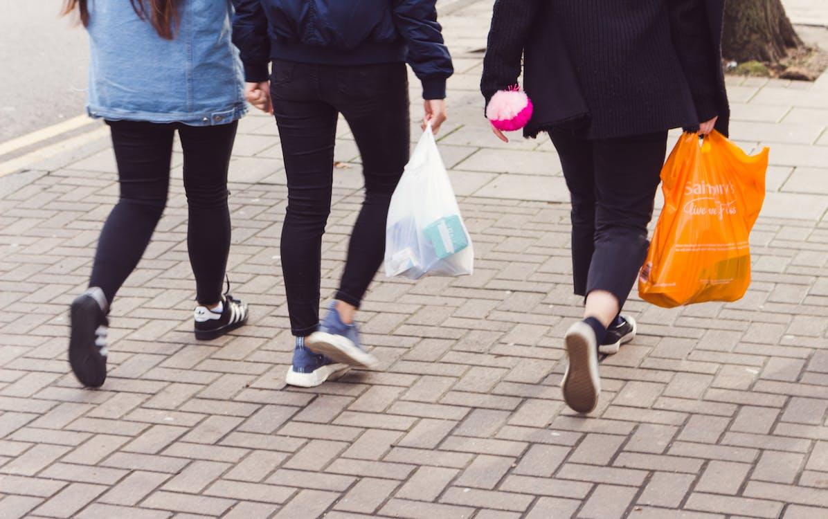 3 people walking, britain, consumer