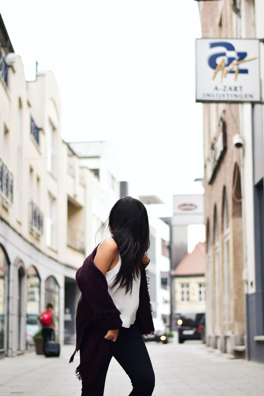 Woman Wearing White Tank Top With Maroon Jacket Crossing N Street