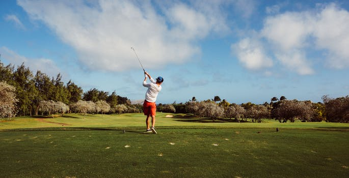 Man in White T Shirt Playing Golf