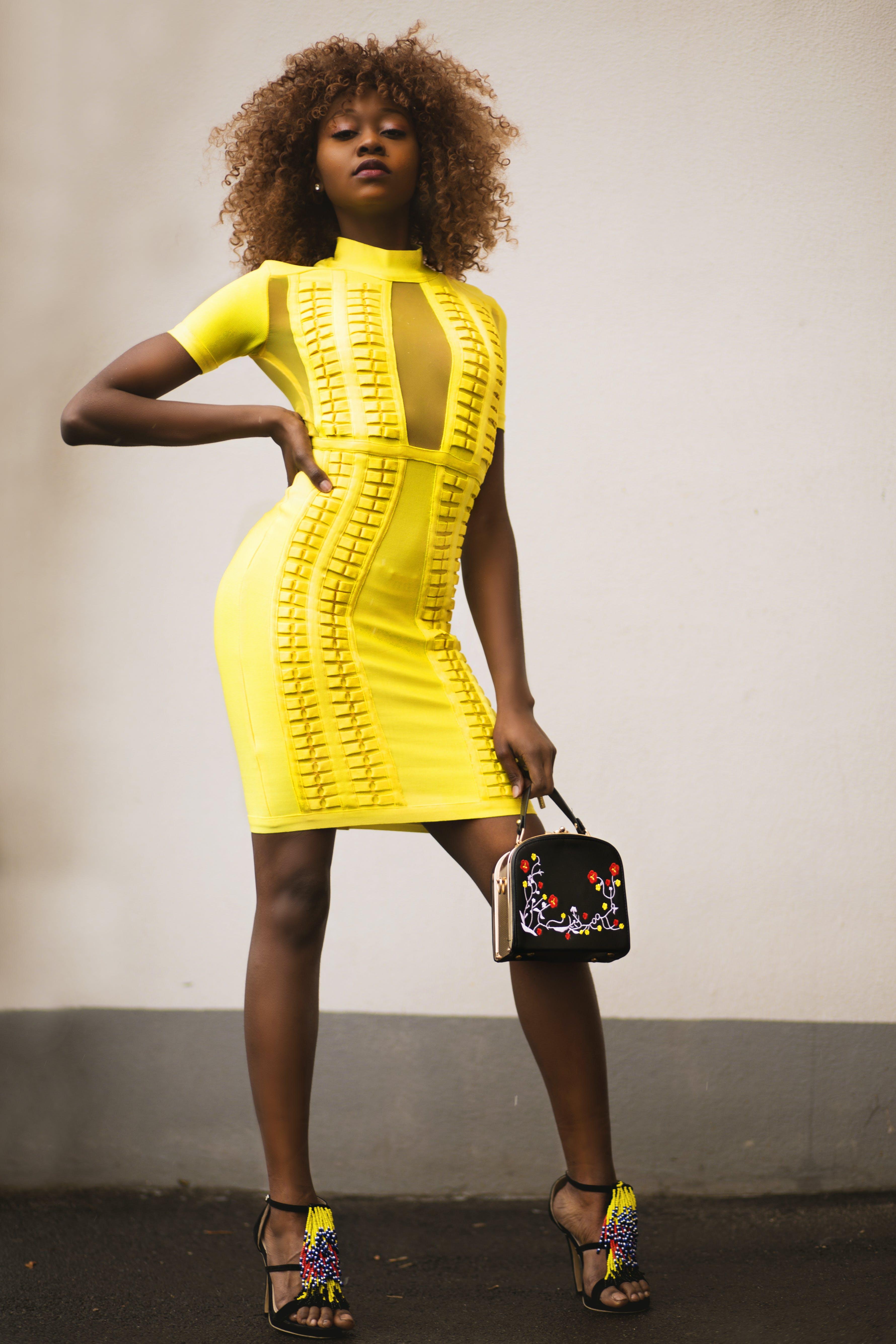 Woman in Yellow Bodycon Mini Dress