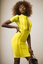 Curly Haired Woman in Yellow Bodycon Dress