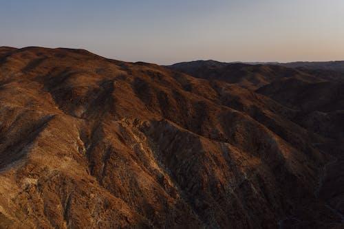 Photos gratuites de aride, aube, colline