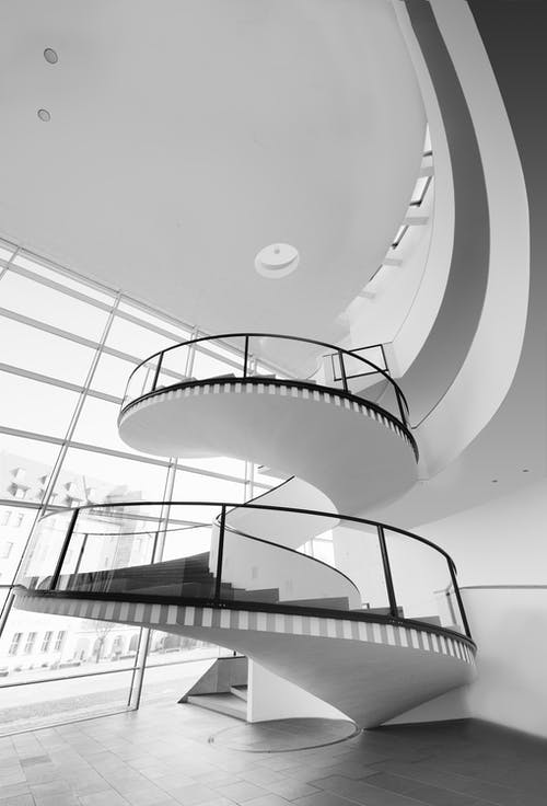 Grayscale Photo of Spiral Stairs