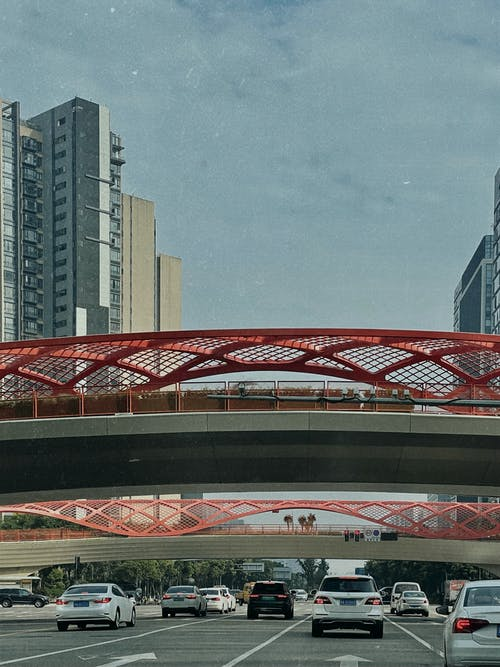 Red and White Bridge over City Buildings