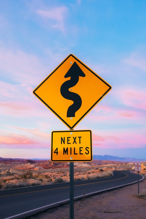 A Winding Road Sign in the Desert