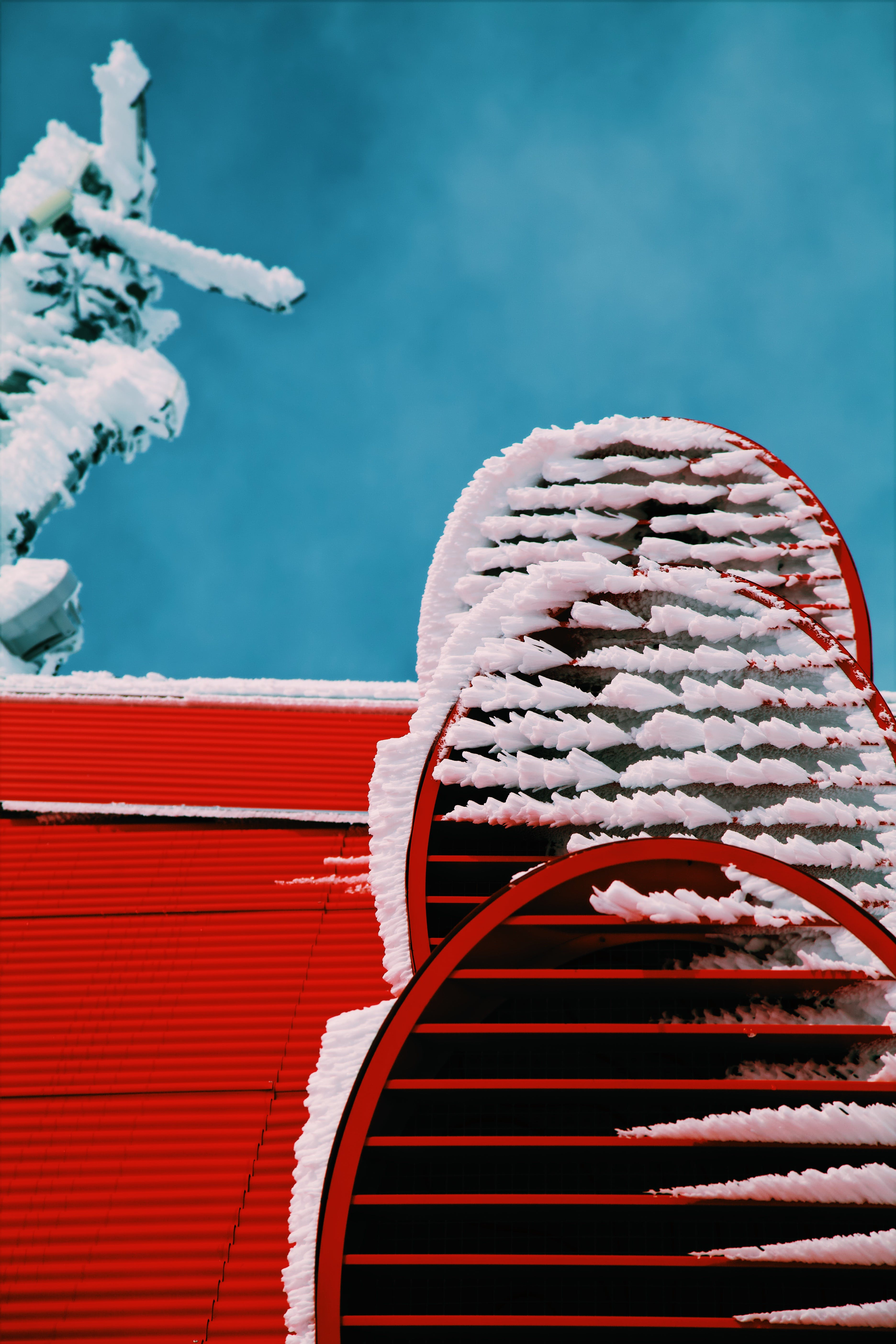 Snows on Red Roof Closeup Photo