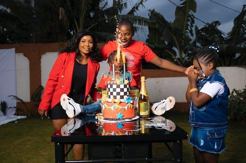 Family Celebrating with Cake