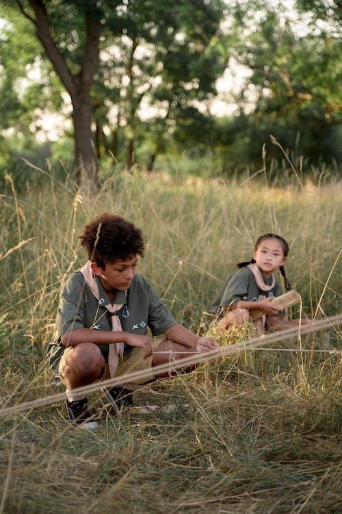 Interracial Kids Sitting on Grass Field