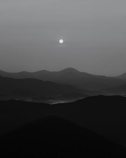 Silhouette of Mountains during Night Time