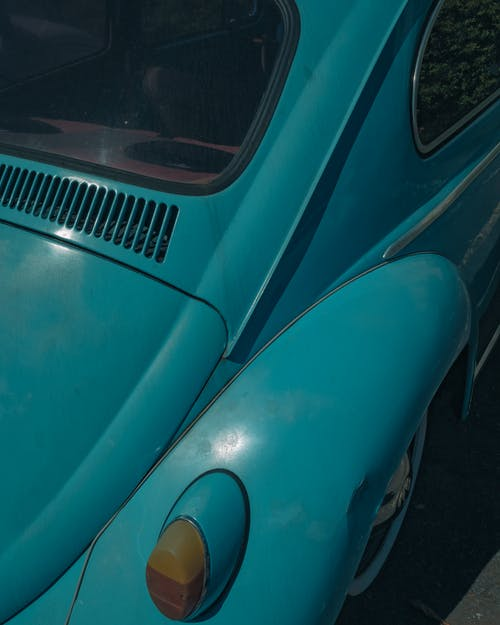 Taillight on Fender of Blue Car