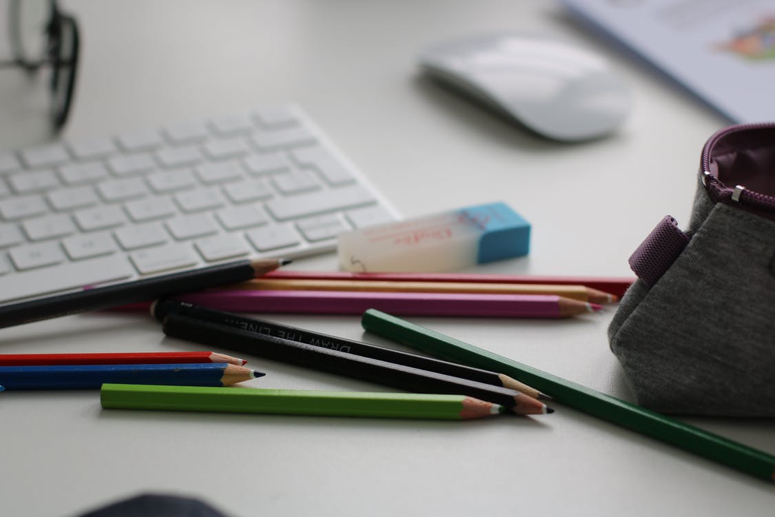 Shallow Focus Photography of Assorted Pencils Near Apple Keyboard and Mouse