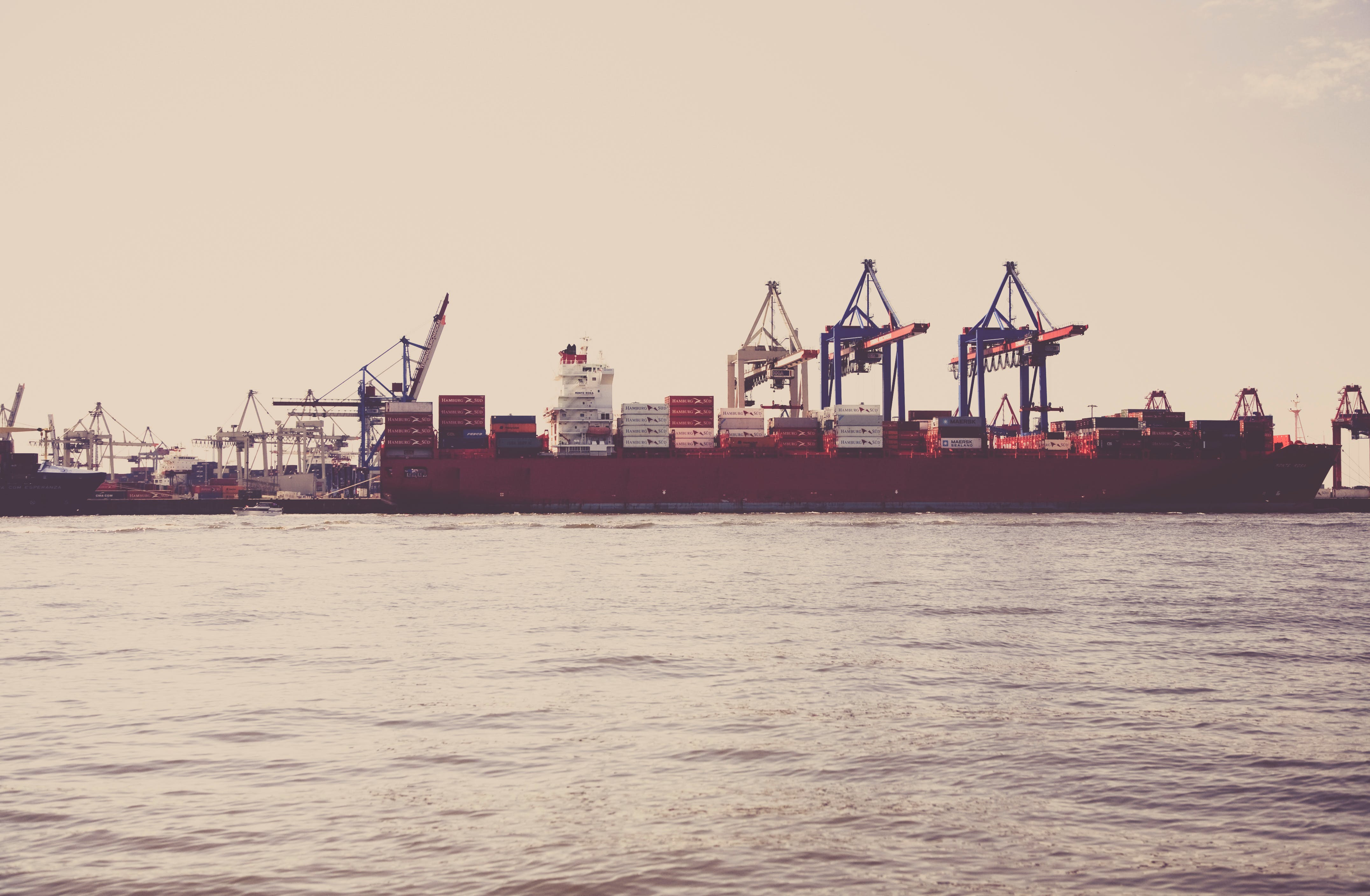 Red Ship on the Sea during Daytime