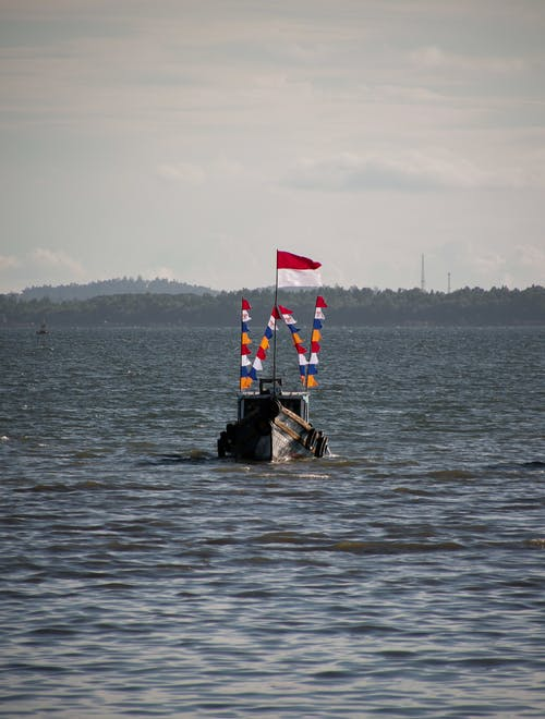 Photos gratuites de bateau, drapeaux, faire signe