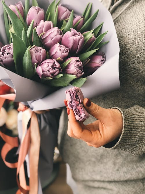 Person Holding Pink Tulip Bouquet