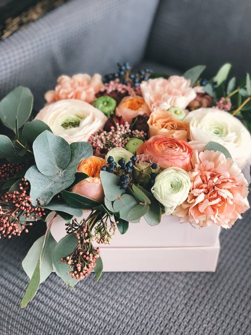 White, Orange, and Green Floral Bouquet Decor