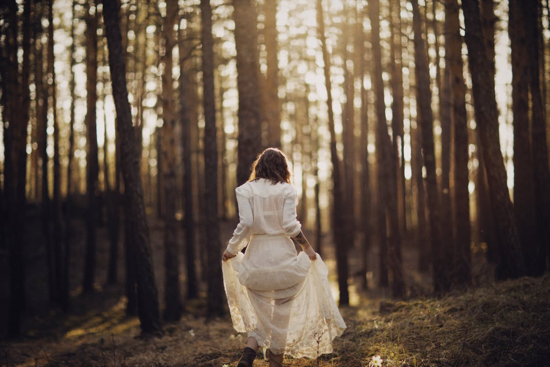 Woman in White Dress in Forest