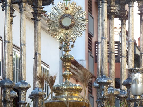 Adorned sun shaped ostensory during Christian procession