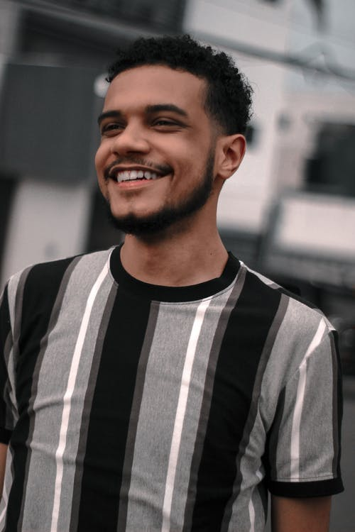 Man in Black and White Striped Crew Neck Shirt Smiling