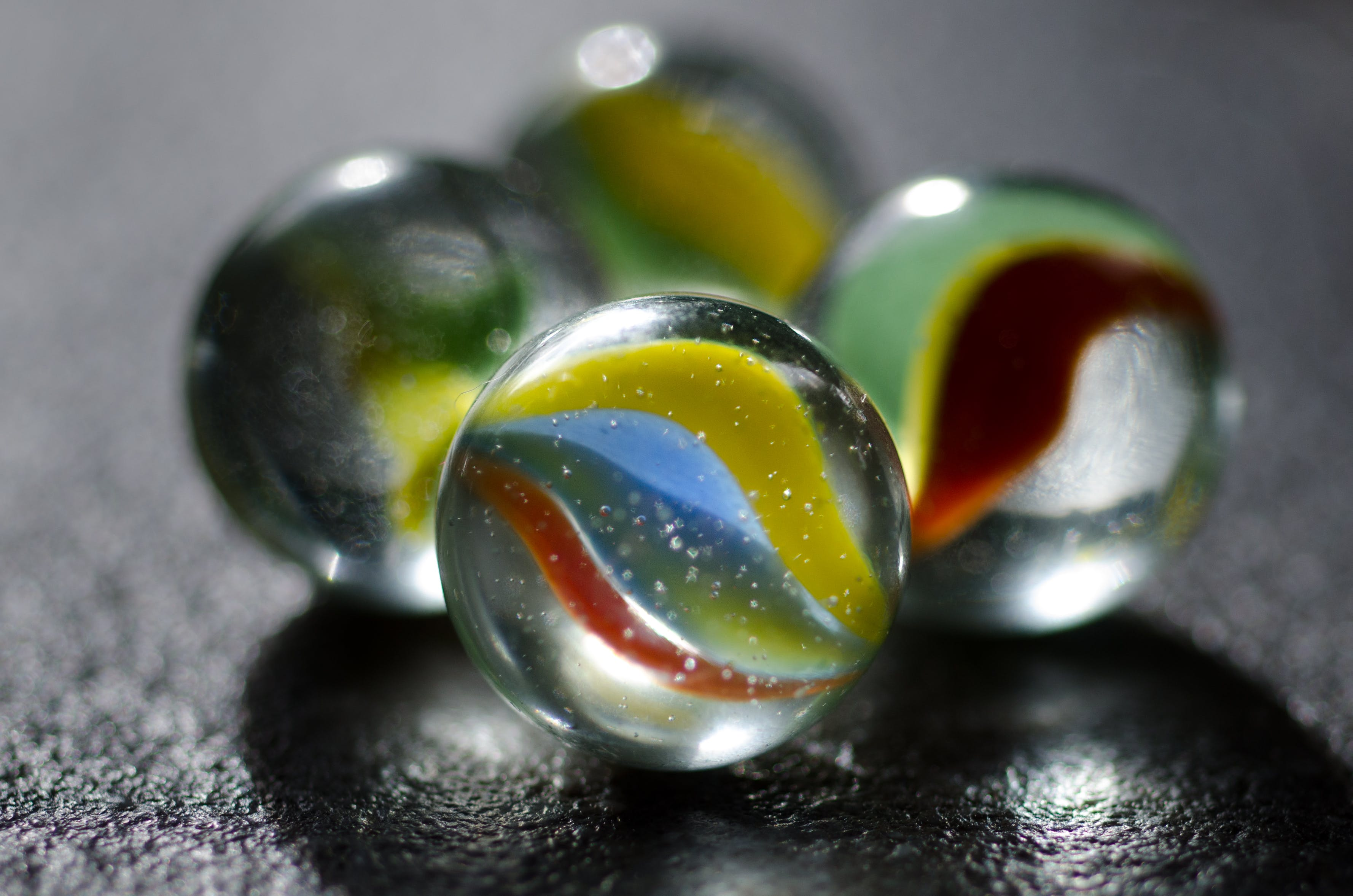 Four Multicolored Marble Toys