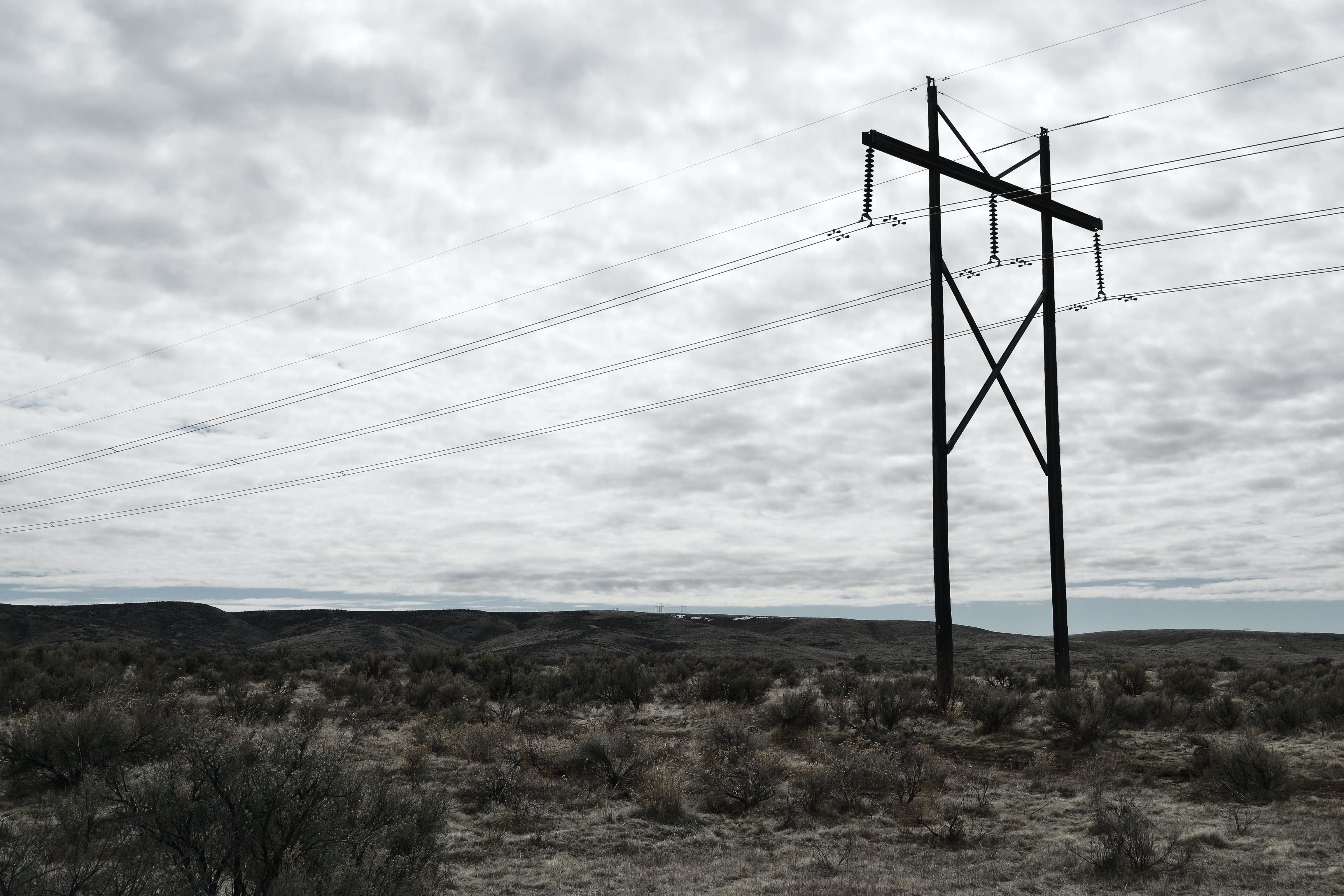 Photograph of Electrical Post on Cloudy Day